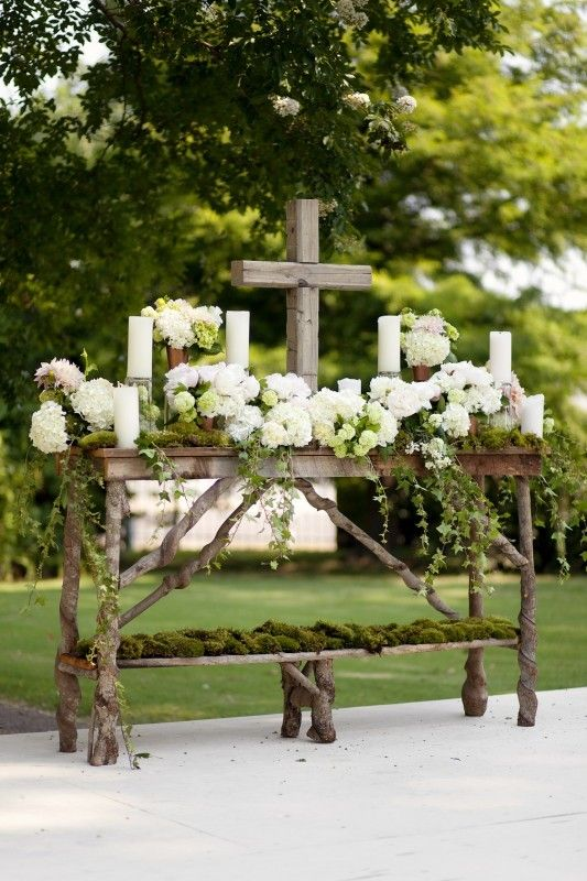 altar - outdoors - Easter? - white candles, white flowers, wooden rustic cross