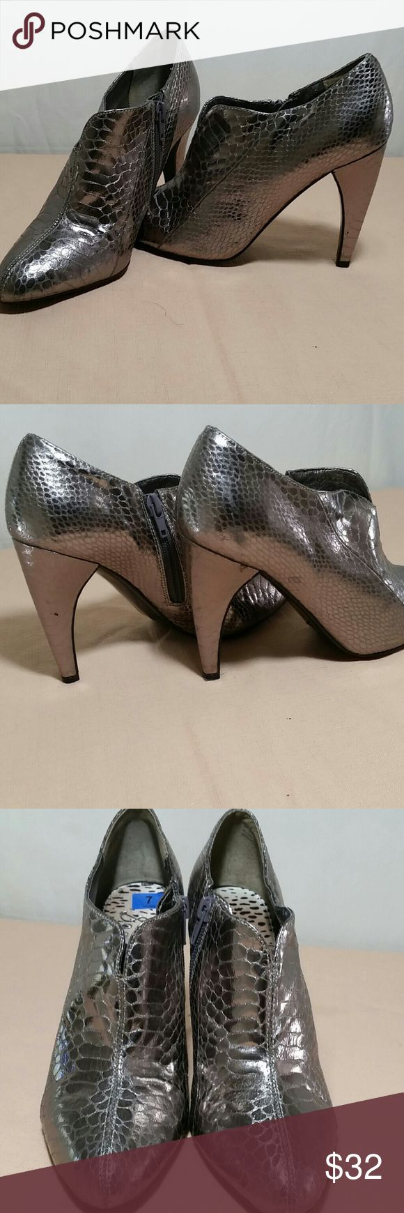 SAM EDELMAN Silver Ankle Boots Size 7 M Beautiful SAM EDELMAN Silver ankle boits.  These ankle boots are a size 7 M.  This pair of SAM EDELMAN Shoes are in excellent like new condition. Sam Edelman Shoes Ankle Boots & Booties