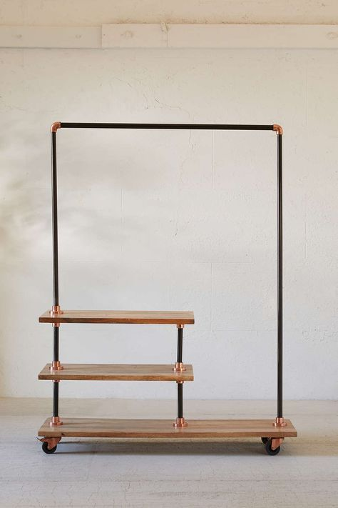 Would love to DIY this look by buying a black metal clothes rack and adding reclaimed wood shelving to it.