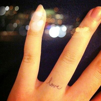 Delicate ring finger tattoo. Want to get the hubby's name.