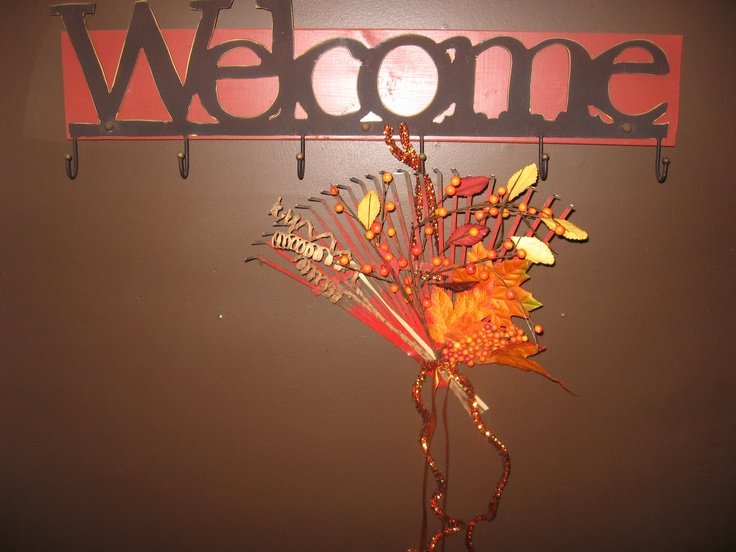 recycle old rake heads to create cool fall wreaths or door hangers