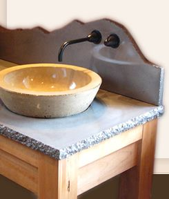 Concrete counter tops. Love the organic look. Some issues with sealers to consider.