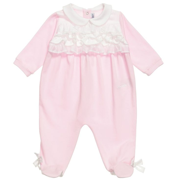 Simonetta Tiny girls babygrow in pale pink with a white ruffle bib and collar. This cute all-in-one outfit has feet and long sleeves and does up at the back with poppers and down one leg.