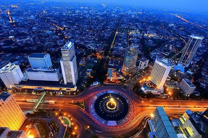 Aerial view of Bundaran HI (below, orange light) and Menteng Area (upper, blue light), is one of the most expensive and prestigious residential area in the city. Menteng Dalam, once the place of president Obama spent his childhood in Jakarta.
