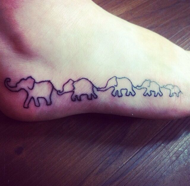 Elephant tattoo. Each elephant represents one of my family members ...