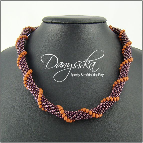 The necklace is made of czech seed beads Preciosa.    It is 45 cm (17.71 inches) long and it can be elongated up to 50 cm (19.68 inches) with extender chain.The rope has approximately 1 cm (0.39 inches) in diameter.    Lobster clasp with extender chain.    Specification:    - color: brown  - length: 45 cm (17.71 inches), max. 50 cm (19.68 inches)  - diameter of the rope: 1 cm (0.39 inches)  - material: czech seed beads Preciosa  - material of components: base metal | Shop this product here…