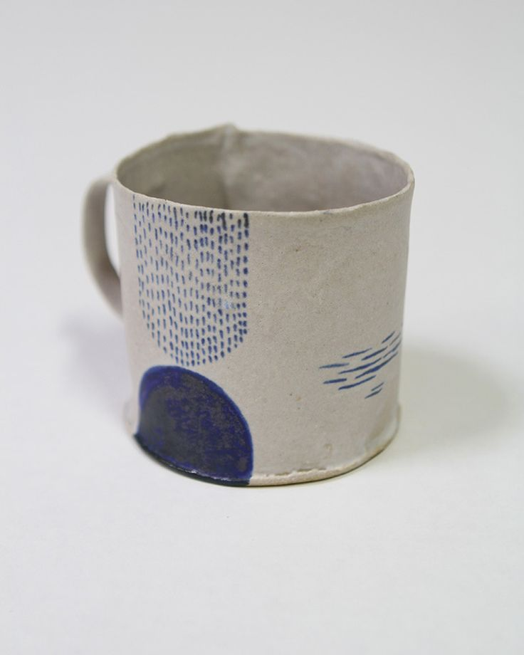 this ceramic mug gave me the idea of painting terra cotta plant pot groupings in monochromatic color patterns, could all be black and white, or red and white for example. I can do sketches of these.