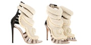 From Glamour.com. I love these!!! I just pinned these shoes then read Kanye West designed them. Price tag.....almost $5,000. The shoes are leather calfskin with pearls.