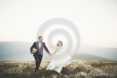 Happy Beautiful Wedding Couple Bride And Groom At Wedding Day Outdoors On The Mountains Rock. Happy Marriage Couple - Download From Over 60 Million High Quality Stock Photos, Images, Vectors. Sign up for FREE today. Image: 91854409