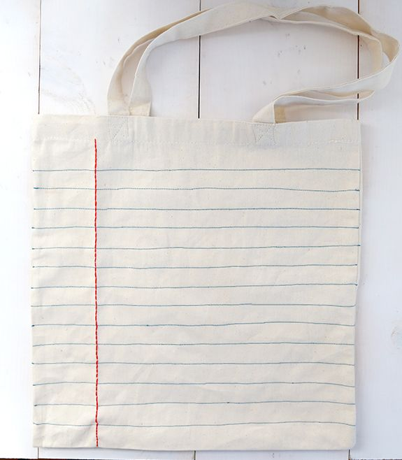 notebook tote. Though honestly,  I'd rip the seams, sew the ink lines and put it back together.