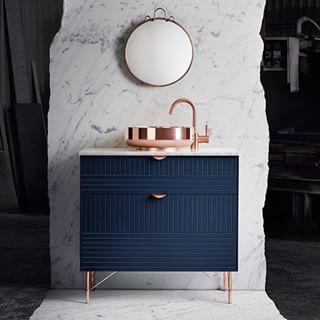 Copper and pinstripes in the bath — love the raw-edge marble
