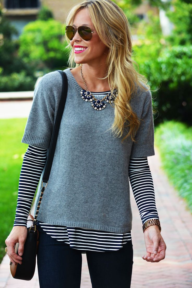 stripes under a short-sleeved sweater.