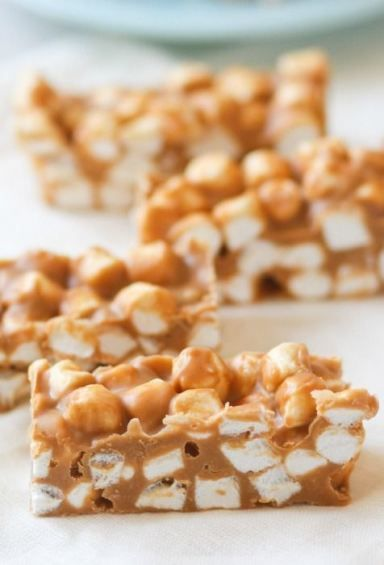 Peanut Butter Marshmallow Bars recipe.   These four ingredient No Bake Peanut Butter Marshmallow Bars come together in a snap!  We loved the light texture and soft candy-like coating.