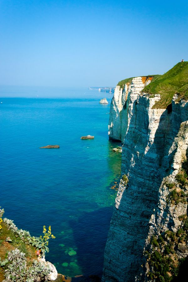 "~Étretat, France~ Étretat is best known for its cliffs, including 3 natural arches and the pointed ""needle""."