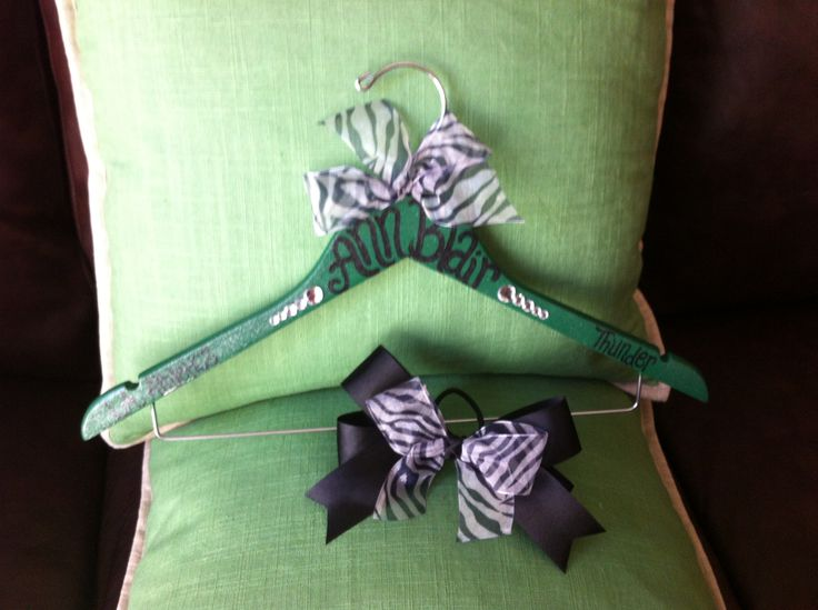 Custom cheer uniform hanger with matching cheer bow, set available at: passionatelypink.etsy.com