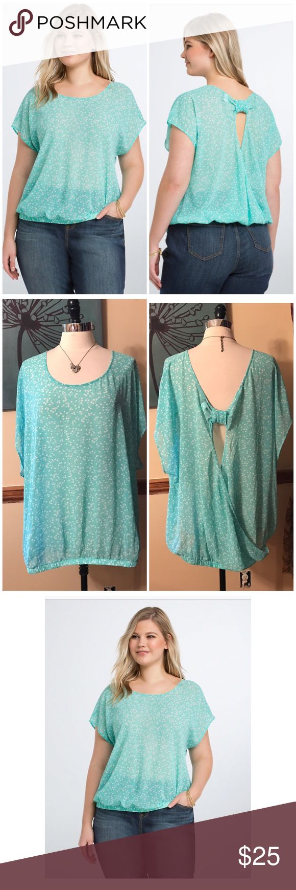 Torrid Floral Chiffon Bow Back Top Size 4. Want to impress your current mood? Sport this sheer mint green chiffon top; its paired with a playful floral print. The open back is held in place by an adorable now, the cut-out revealing a sliver of skin. A banded bottom lends dramatic definition. Polyester. EUC $38.50 torrid Tops Blouses