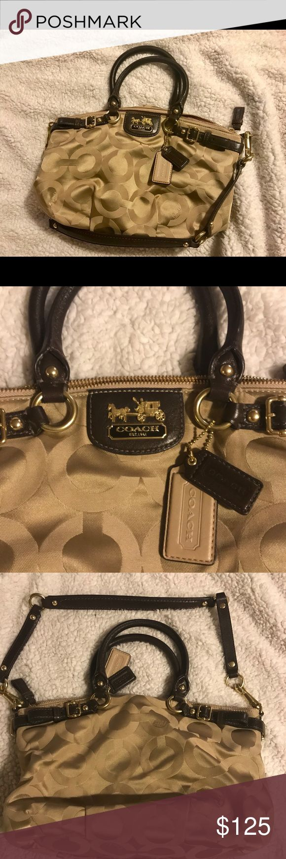 "👜NWOT Coach purse, gold & brown👜 Brand new, very clean Coach purse.  Gold with brown straps.  Could be used as a satchel (smaller straps) or shoulder bag (adjustable shoulder strap)👍🏻. Approximately 12"" wide x 8 1/2"" tall x 3"" depth.  Plenty of inside pockets, one that zips.  Would really go great with any outfit.  Very versatile. Coach Bags Shoulder Bags"