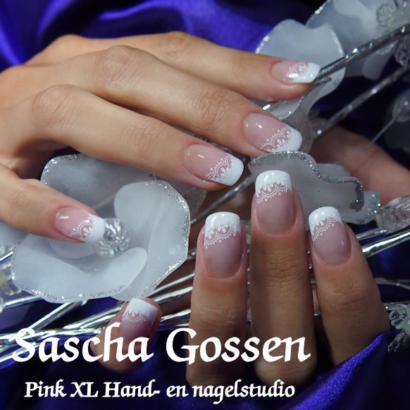 Lace nail art on a white french manicure ♡