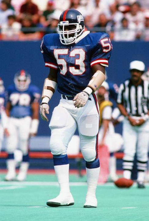 New York Giants linebacker Harry Carson (53) looks on during the NFL football game against the St. Louis Cardinals on September 22, 1985 in East Rutherford, New Jersey. The Giants won the game 27-17. (AP Photo/Paul Spinelli)