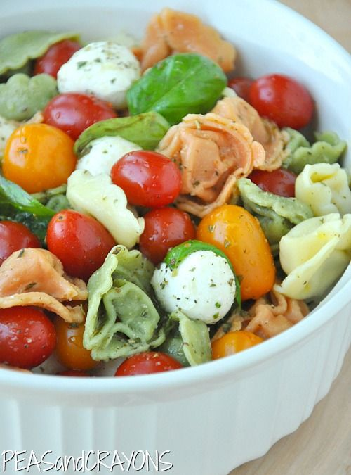 Caprese Tortellini Pasta Salad - 9oz pkg of tri-color cheese tortellini, mozzarella balls, cherry tomatoes 1/2 cup italian dressing, fresh basil leaves