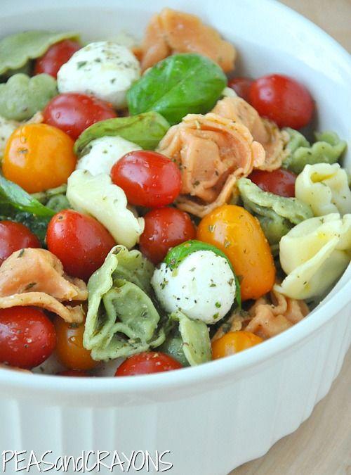 Caprese Tortellini Pasta Salad - 9oz pkg of tri-color cheese tortellini, mozzarella balls, cherry tomatoes 1/2 cup italian dressing, fresh basil leaves - delicious!!