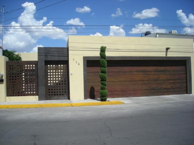 Portones hierro forjado buscar con google portones for Puertas de garaje modernas