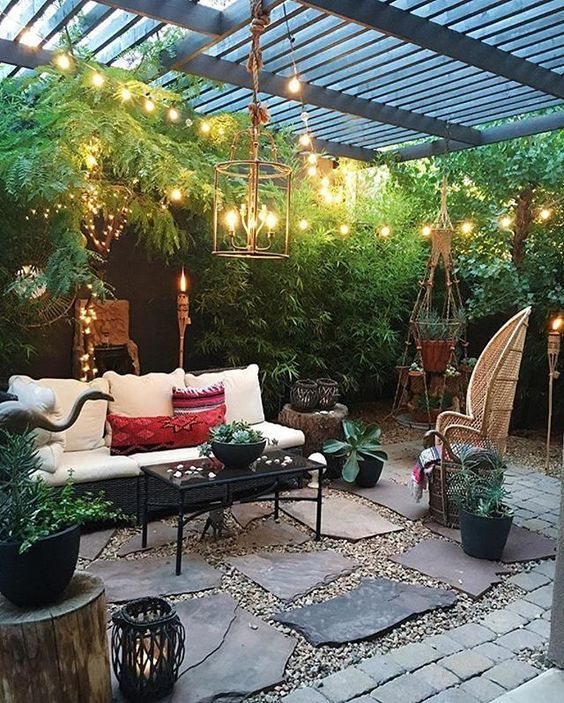 ... Peaceful back patio space. Lighting is so important! Twinkle lights create a soft atmosphere.