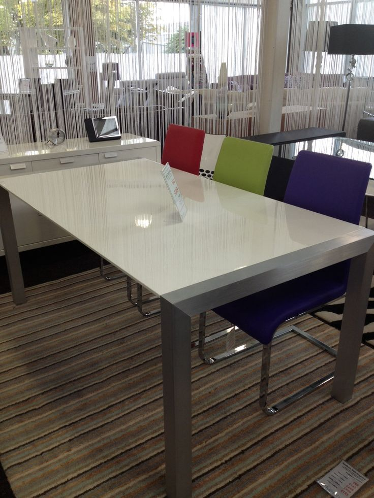 White gloss extending table and multi colour chairs. Furniche Milton Keynes