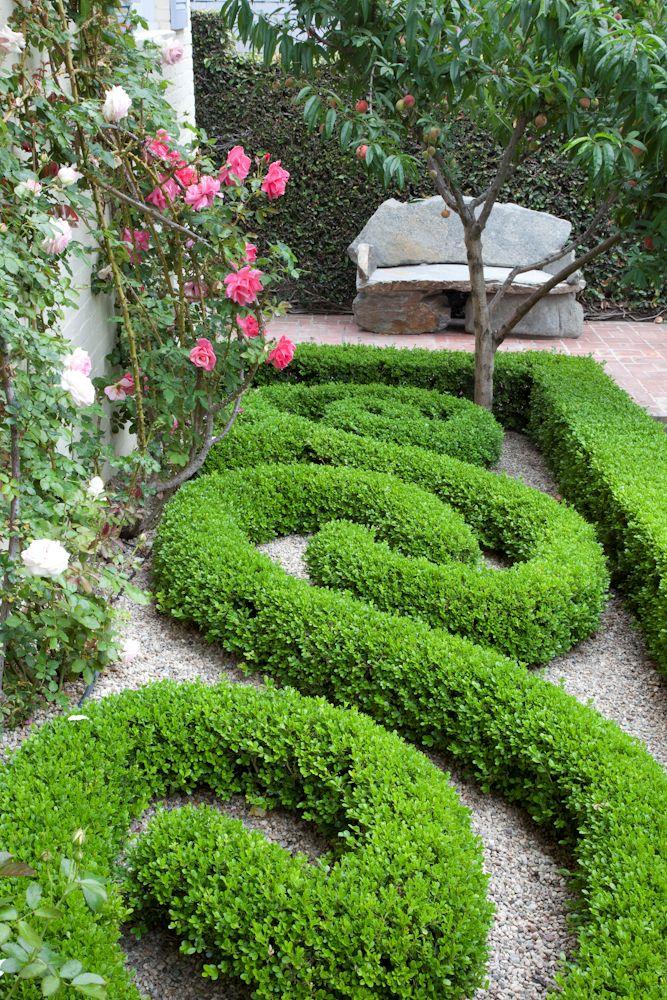 Lovely boxwood design-beautiful stone bench
