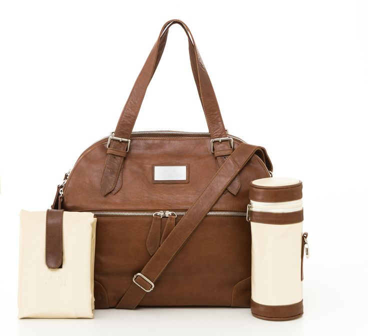 Budu Baby Diaper Bag in Tan leather. This stylish nappy bag includes insulated bottle holder, padded change mat, key clip and plenty of storage. (http://www.budu.com.au/budu-baby-bag-tan/)
