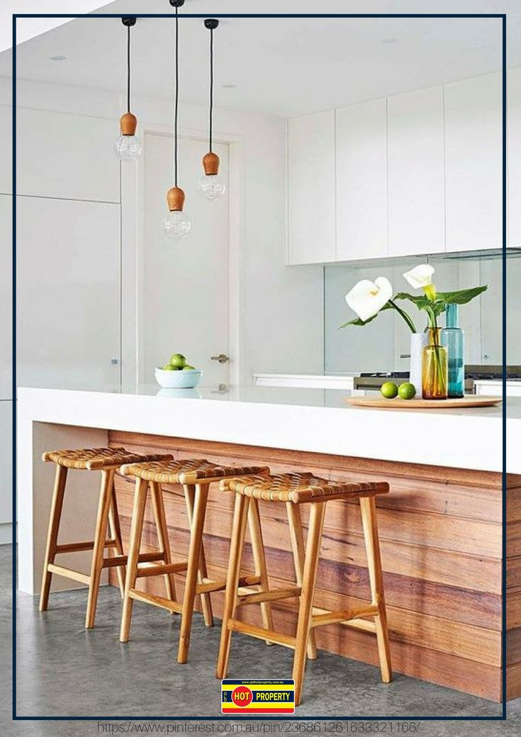 An attractive kitchen fitted with stools for a social space.