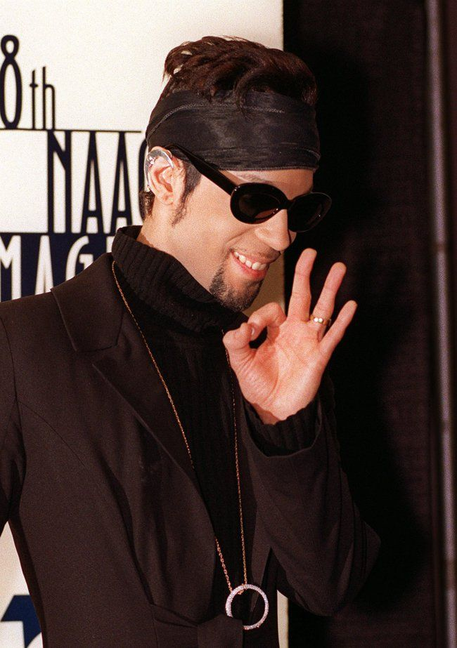 """Federal tax docs show Prince's other legacy: charitable giving  -    The artist formerly known as Prince give the media the """"Okay"""" sign backstage at the 28th annual NAACP Image Awards ceremony Saturday Feb. 8, 1997 in Pasadena, Calif. This year's theme for the show is """"Celebration of Family."""" (AP Photo/Mark J. Terrill)"""