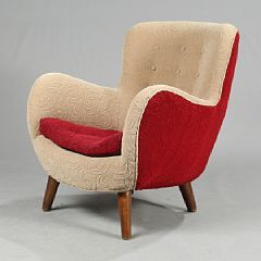 Frits Schlegel, ascribed to: An organic shaped easy chair upholstered with red and grey wool, stained beech legs. 1950-1960s.