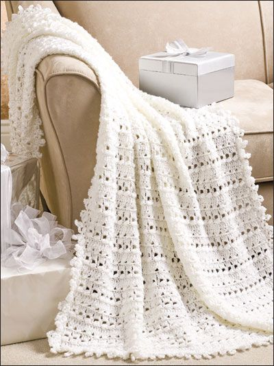 "Quick and easy, this lacy afghan will be treasured by any happy couple. This e-Pattern was originally published in Crochet World June 2009. Size: 45"" x 62"". Made with medium (worsted weight) yarn and size I/9/5.5mm needles. Skill Level: Intermediate"