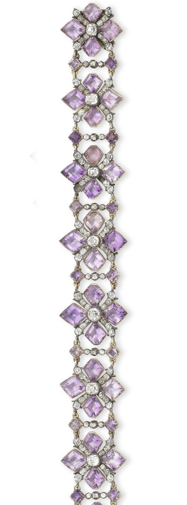 A rare 18th century amethyst and diamond bracelet.  The openwork strap composed of kite-shaped amethysts and cushion-shaped and old brilliant-cut diamond quatrefoils, mounted in silver and gold, closed-back settings throughout, length 28.0cm