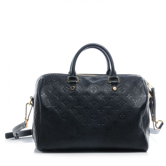 This is an authentic LOUIS VUITTON Monogram Empreinte Speedy Bandouliere 30 in Noir Black.   This stunning Speedy style tote is here crafted of Louis Vuitton monogram embossed leather.