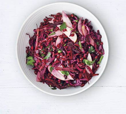 This salad of shredded vegetables dotted with apple is a vibrant and healthier alternative to coleslaw