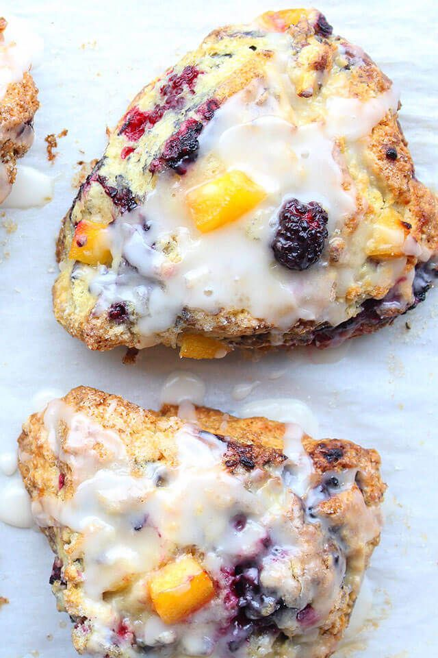 Sweet peaches and tangy blackberries pair beautifully in these buttery and tender Peach Blackberry Scones with Vanilla Glaze.