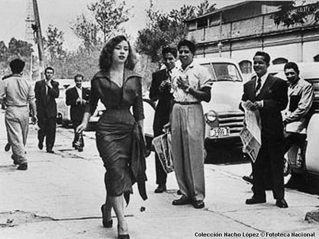 Photo of an unnamed woman stoically braving the wolf-filled streets of Mexico City, circa 1950. (Note: She has been identified as Mexican movie and television actress Maty Huitrón.) by:Nacho Lopez