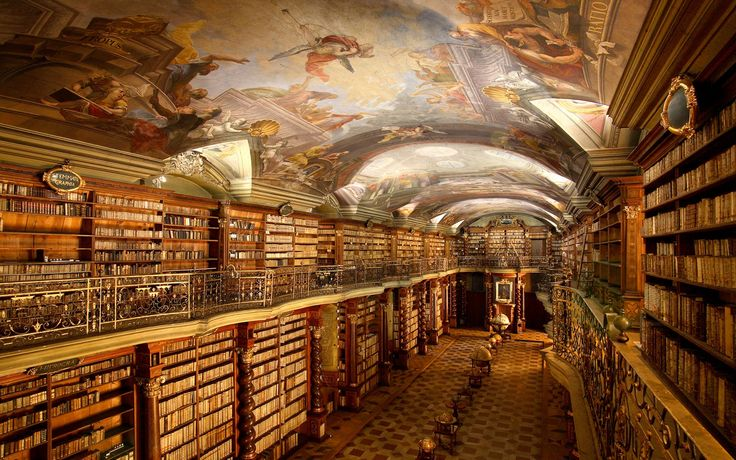 """The baroque Library Hall, with its rare gilded globes and spectacular frescoes depicting science and art, is just one building in the vast Clementinum complex. Legend says the Jesuits had only one book when they started building the library in 1622; when they were done, the collection had swelled to 20,000 volumes. Labels on the bookshelves are original to the library's opening, as are volumes with """"whitened backs and red marks,"""" markers left by the Jesuits. Tours run daily."""