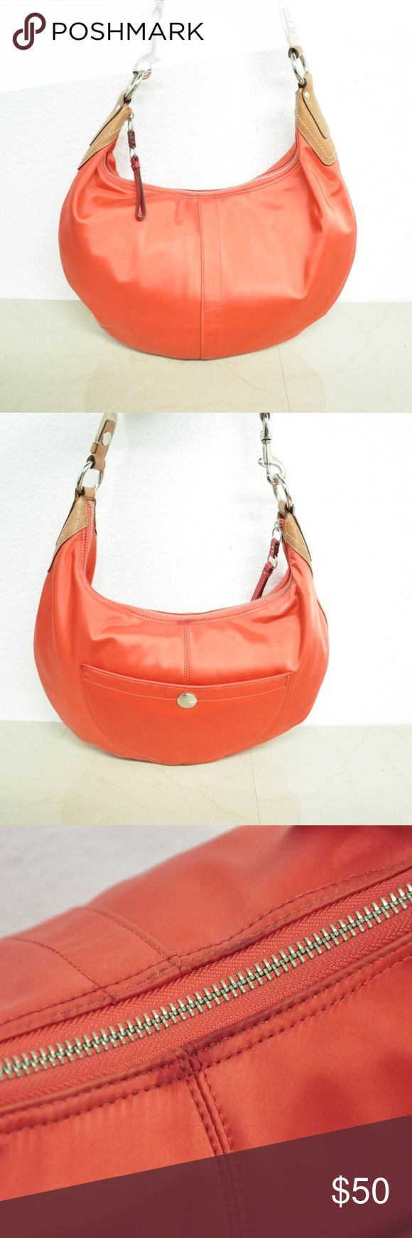Coach 11743 Hampton Satin Hobo Orange Shoulder Bag Coach 11743 Hampton Satin Hobo Orange Shoulder Bag the bag is in good shape it has some stains near the zipper(as pictured) the lining is in great shape height 10'' depth 3'' width 17'' strap drop: 11'' Coach Bags Shoulder Bags