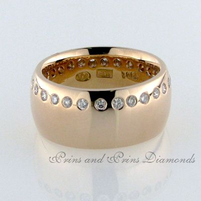 There are 32 = 0.73ct IJ/VS – SI round brilliant cut diamonds swiss set on the one side of a chunky rose gold design