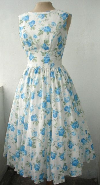50s inspired cocktail dress made from cotton with cute blue floral print. Dress design can be made to measure. All sizes welcome.. $79.00, via Etsy.