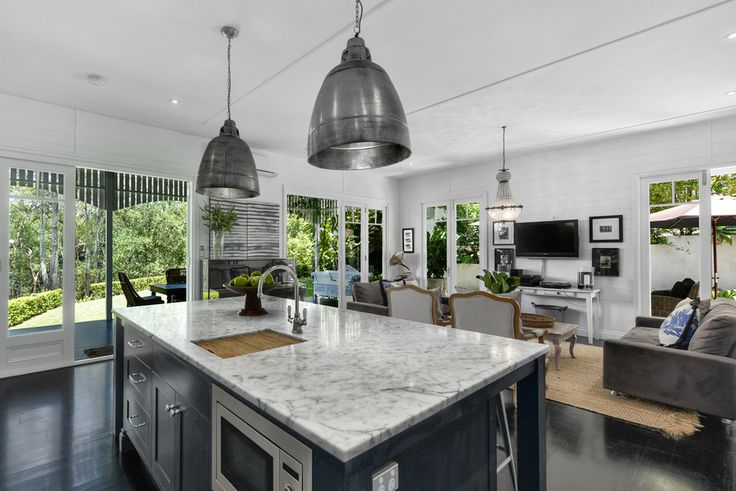 Kitchen/Living for a renovated Queenslander. Open-plan and ground-level to watch the sprogs......