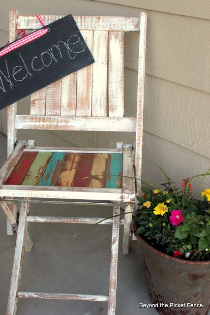 Cute welcome for the front porch.-I only have about this much room for something. Don't live the finish on the chair, but maybe I can find something similar and paint it to match my house.