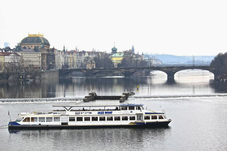 Jazz boat on Vltava River. View from Charles Bridge, Prague. January 2014
