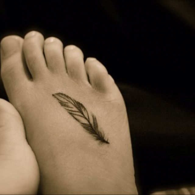 Normally I don't like tattoos ... but I like the discreet feather idea for a tattoo. This may be cheesy, but it makes me think of Forrest Gump and how our lives are like feathers in the wind... being pushed by the wind and landing exactly where it is supposed to land.