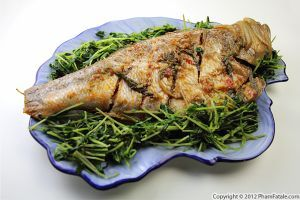 Here\'s the fish dish I made in parallel to the mock fish I made for my vegetarian husband last Tuesday. I baked Pacific Ocean perch using a very simple recipe. I flavored the fish with red Thai chiles, onions and Thai basil.I served the fish on a bed of Chinese pea shoots and kept the meal fairly healthy. Enjoy!
