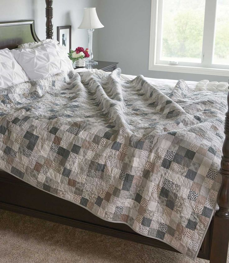"This queen-size quilt pattern is created with subtle neutral prints and solids. Strip sets from 2½"" precuts make sewing so simple and so much fun!"