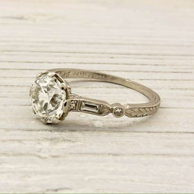 I love this simple vintage wedding ring. Love but I'd modernize the main stone